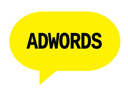 ADWORDS text in yellow speech bubble simple sign with rounded corners.