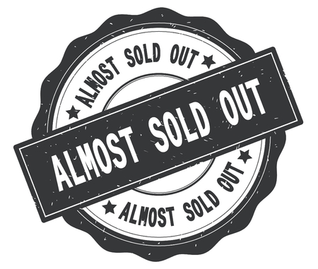 ALMOST SOLD OUT text, written on grey, lacey border, round vintage textured badge stamp. Stock Photo