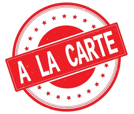 A LA CARTE text, on round vintage rubber stamp sign with stars, red color. Stock Photo