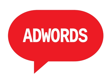 ADWORDS text in red speech bubble simple sign with rounded corners.