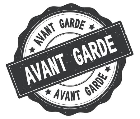 AVANT GARDE text, written on grey, lacey border, round vintage textured badge stamp. Stock Photo