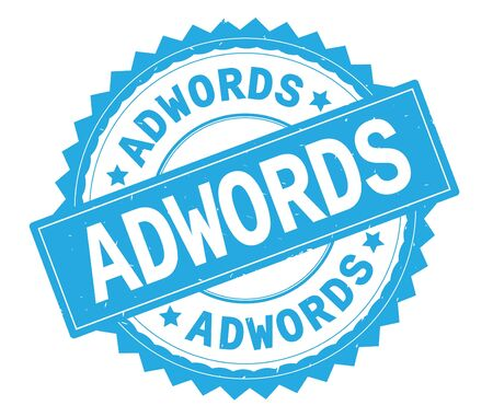 ADWORDS blue text round stamp, with zig zag border and vintage texture.