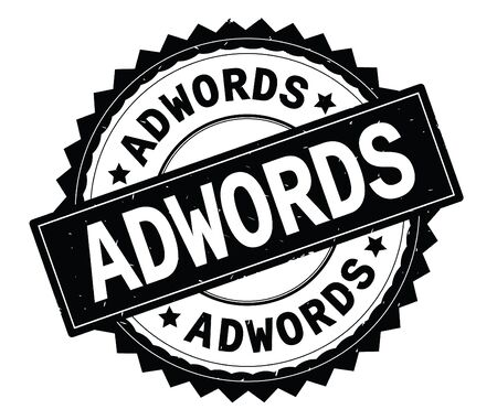 ADWORDS black text round stamp, with zig zag border and vintage texture. Stock Photo