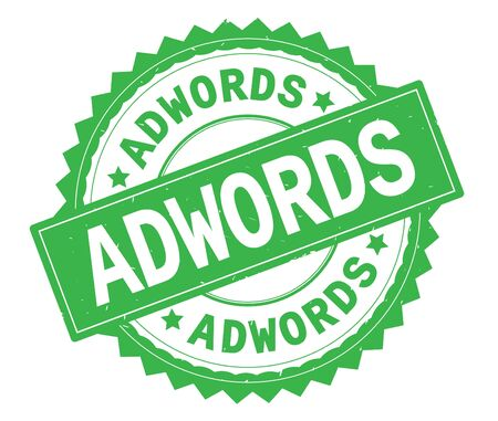 ADWORDS green text round stamp, with zig zag border and vintage texture. Stock Photo