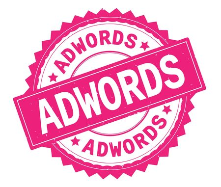 ADWORDS pink text round stamp, with zig zag border and vintage texture. Stock Photo