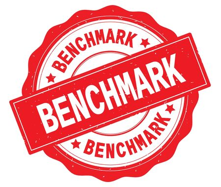 BENCHMARK text, written on red, lacey border, round vintage textured badge stamp. Stock Photo
