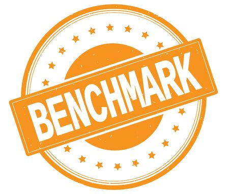 BENCHMARK text, on round vintage rubber stamp sign with stars, orange color.