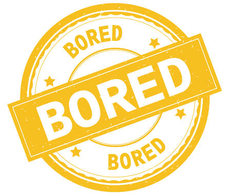 BORED , written text on yellow round rubber vintage textured stamp. Stock Photo