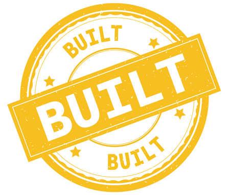 BUILT , written text on yellow round rubber vintage textured stamp.
