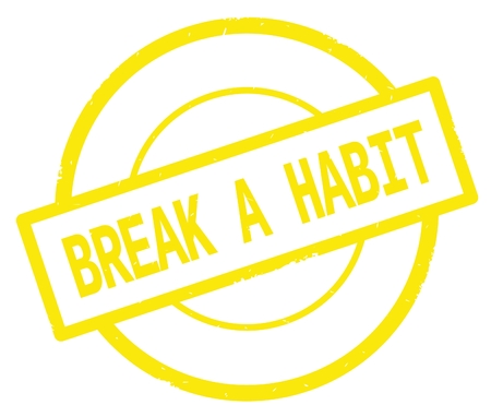 BREAK A HABIT text, written on yellow simple circle rubber vintage stamp. Stock Photo