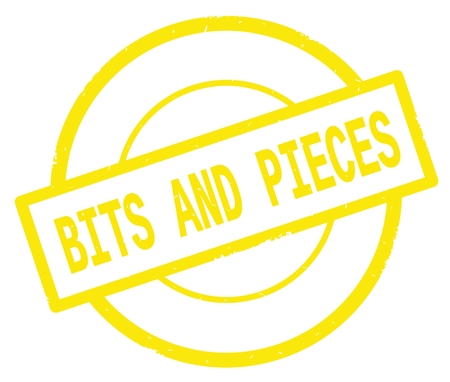 BITS AND PIECES text, written on yellow simple circle rubber vintage stamp. Stock Photo
