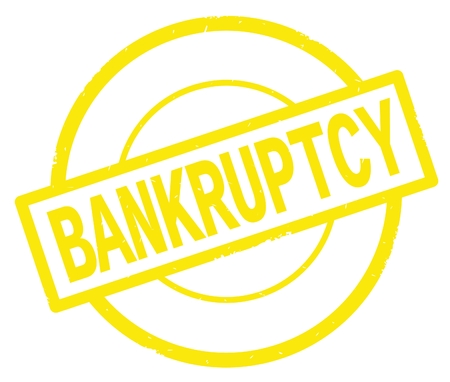 BANKRUPTCY text, written on yellow simple circle rubber vintage stamp.