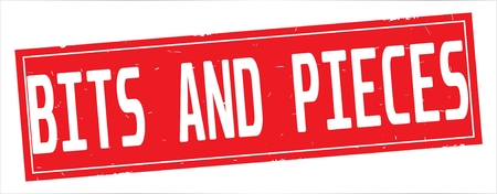 BITS AND PIECES text, on full red rectangle vintage textured stamp sign. Stock Photo