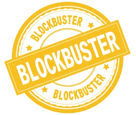 BLOCKBUSTER , written text on yellow round rubber vintage textured stamp. Stock Photo