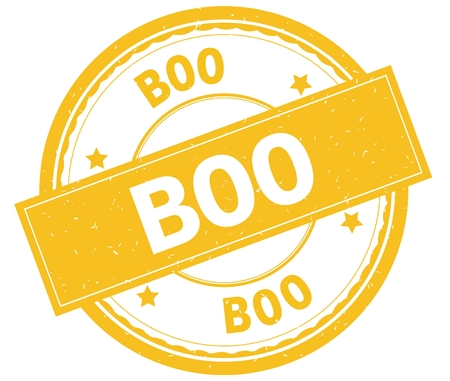 BOO , written text on yellow round rubber vintage textured stamp. Stock Photo