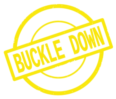 BUCKLE DOWN text, written on yellow simple circle rubber vintage stamp. Stock Photo
