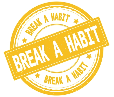 BREAK A HABIT , written text on yellow round rubber vintage textured stamp.