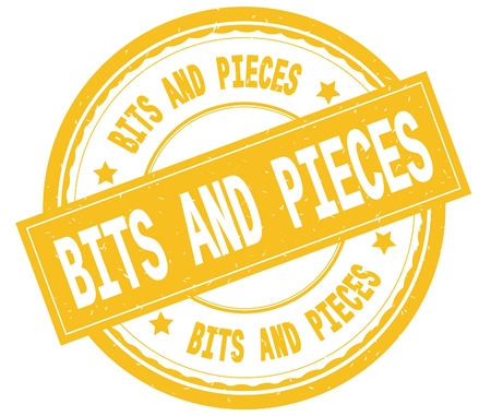 BITS AND PIECES , written text on yellow round rubber vintage textured stamp.