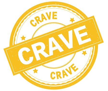 CRAVE , written text on yellow round rubber vintage textured stamp. Stock Photo