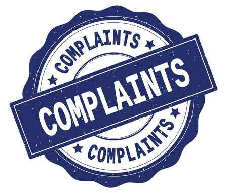 COMPLAINTS text, written on blue, lacey border, round vintage textured badge stamp.