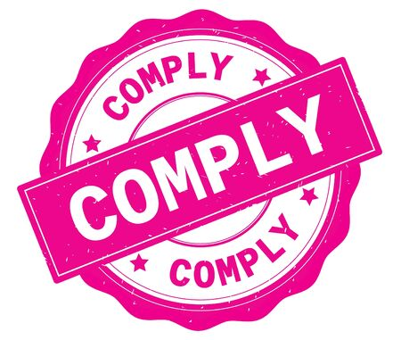 COMPLY text, written on pink, lacey border, round vintage textured badge stamp. Stock Photo