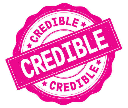 CREDIBLE text, written on pink, lacey border, round vintage textured badge stamp. Stock Photo