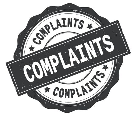 COMPLAINTS text, written on grey, lacey border, round vintage textured badge stamp. Stock Photo - 90389159