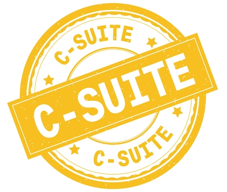 C SUITE , written text on yellow round rubber vintage textured stamp. Stock Photo