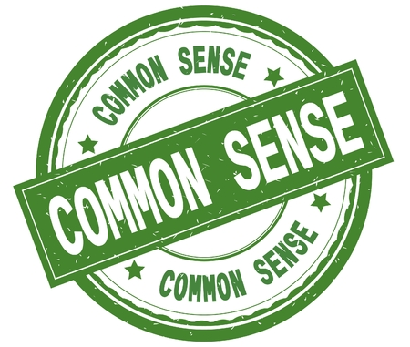 COMMON SENSE , written text on green round rubber vintage textured stamp.
