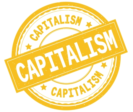 CAPITALISM , written text on yellow round rubber vintage textured stamp.