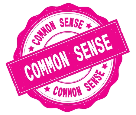COMMON SENSE text, written on pink, lacey border, round vintage textured badge stamp.