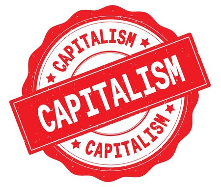 CAPITALISM text, written on red, lacey border, round vintage textured badge stamp. Banco de Imagens