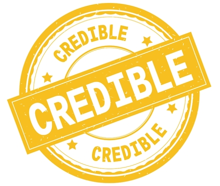 CREDIBLE , written text on yellow round rubber vintage textured stamp. Stock Photo