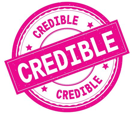 CREDIBLE , written text on pink round rubber vintage textured stamp. Stock Photo