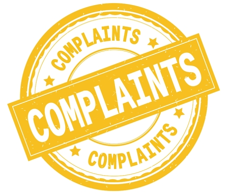COMPLAINTS , written text on yellow round rubber vintage textured stamp.