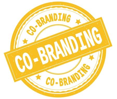 CO BRANDING , written text on yellow round rubber vintage textured stamp.