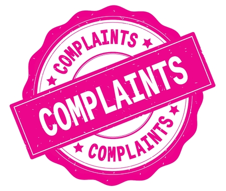 COMPLAINTS text, written on pink, lacey border, round vintage textured badge stamp.