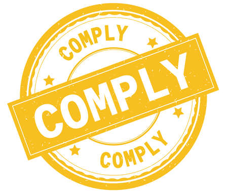 COMPLY , written text on yellow round rubber vintage textured stamp. Stock Photo