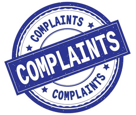 COMPLAINTS , written text on blue round rubber vintage textured stamp. Stock Photo
