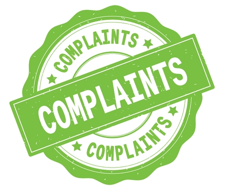 COMPLAINTS text, written on green, lacey border, round vintage textured badge stamp.