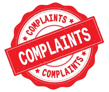 COMPLAINTS text, written on red, lacey border, round vintage textured badge stamp. Stock Photo