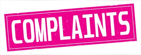 COMPLAINTS text, on full pink rectangle vintage textured stamp sign. Stock Photo