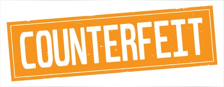 COUNTERFEIT text, on full orange rectangle vintage textured stamp sign. Фото со стока