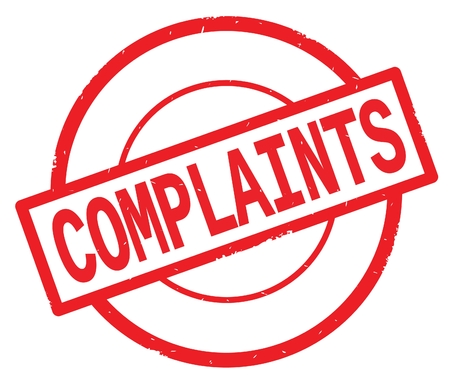 COMPLAINTS text, written on red simple circle rubber vintage stamp. Stock Photo