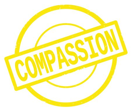 COMPASSION text, written on yellow simple circle rubber vintage stamp. Stock Photo
