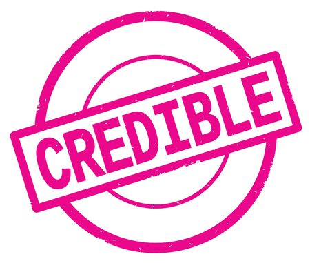 CREDIBLE text, written on pink simple circle rubber vintage stamp. Фото со стока