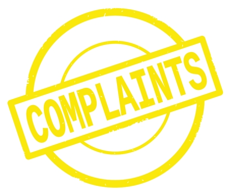 COMPLAINTS text, written on yellow simple circle rubber vintage stamp. Stock Photo