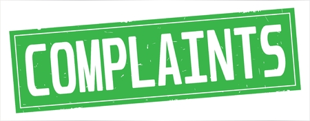 COMPLAINTS text, on full green rectangle vintage textured stamp sign. Stock Photo