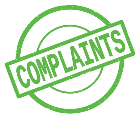 COMPLAINTS text, written on green simple circle rubber vintage stamp. Stock Photo
