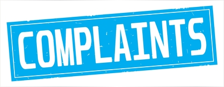 COMPLAINTS text, on full cyan rectangle vintage textured stamp sign.